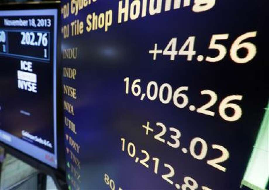 A board on the floor of the New York Stock Exchange shows the Dow Jones industrial average above 16,000, Monday, Nov. 18, 2013. The DJIA crossed 16,000 points for the first time early Monday and the Standard & Poor's 500 index crossed 1,800 points. (AP Photo/Richard Drew) Photo: AP / AP