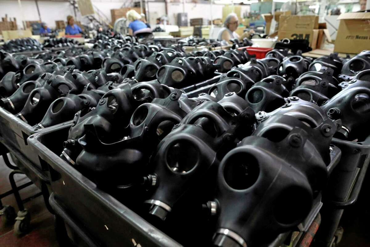 Israeli workers are seen at the Shalon gas mask factory in Kiryat Gat, Israel, Thursday, Aug. 29, 2013. Israeli police say thousands of Israelis are crowding gas-mask distribution facilities, readying for a potential conflict in Syria. (AP Photo/Tsafrir Abayov)