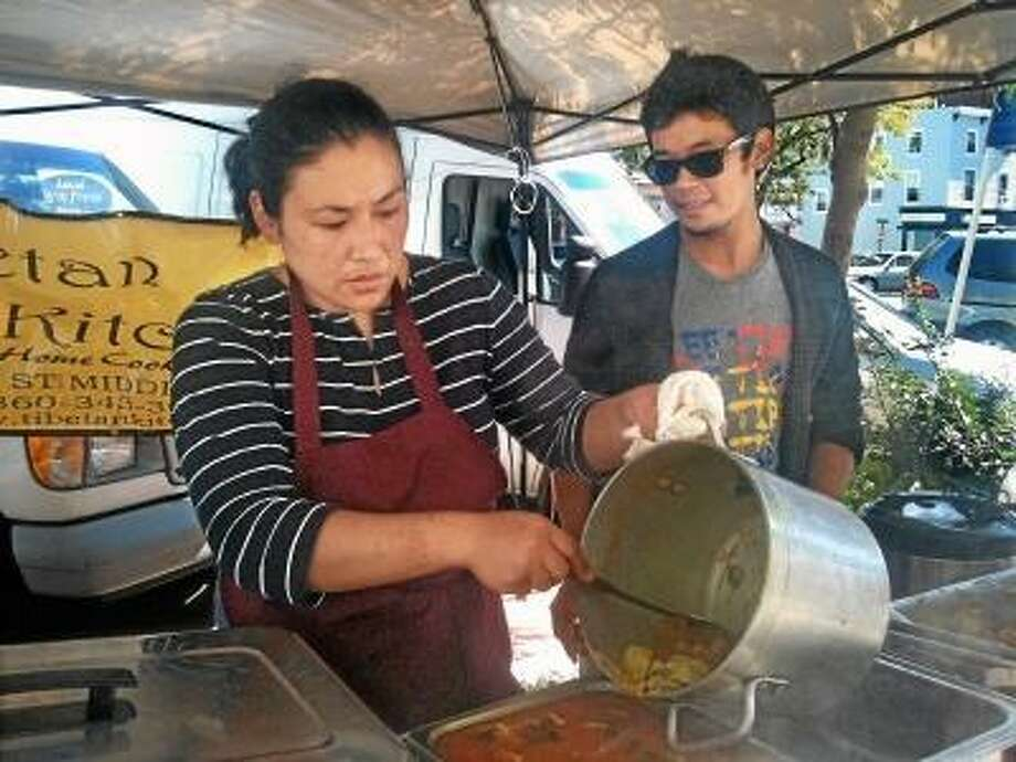 The owners of Tibetan Kitchen, Tsering Yangzom and Shevab Gyaltsen, at the North End Action Team's farmer's market.