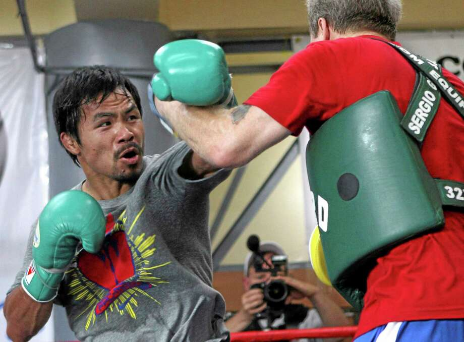 Freddie Roach, Manny Pacquiao's trainer, was involved in a physical altercation with the entourage of opponent Brandon Rios on Wednesday, days before their fight. Photo: Bullit Marquez — The Associated Press  / AP
