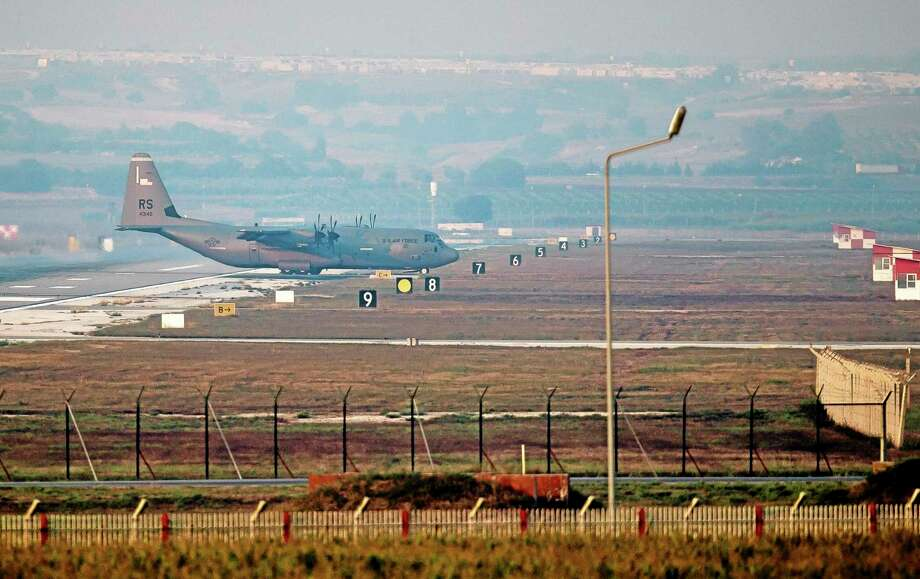A US Air Force plane maneuvers on the runway at Incirlik Air Base, Turkey, Thursday, Aug. 29, 2013.  U.N. Secretary-General Ban Ki-moon said the Inspection team in Syria is expected to complete its work Friday and report to him Saturday. (AP Photo/Vadim Ghirda) Photo: AP / AP