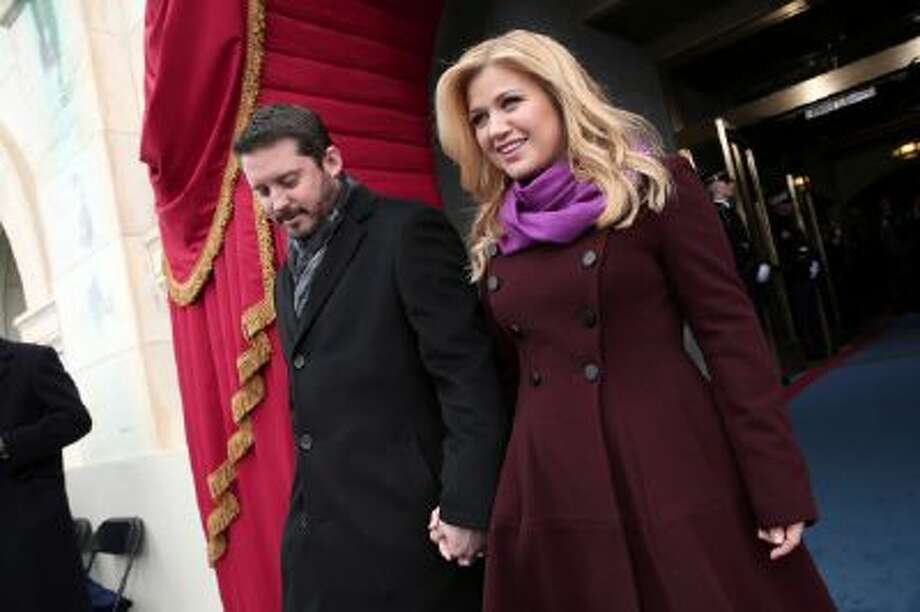 In this Jan. 21, 2013 photo, singer Kelly Clarkson and Brandon Blackstock arrive on the West Front of the Capitol in Washington.