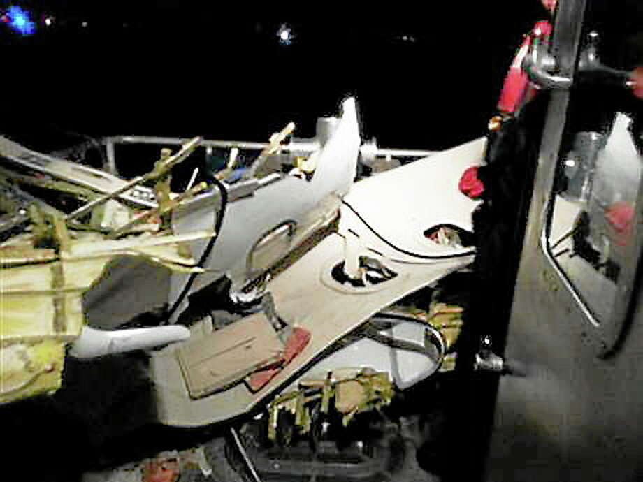 Wreckage of the plane that crashed off the coast of Fort Lauderdale, Fla., is brought aboard a Coast Guard boat Tuesday, Nov. 19, 2013, in Fort Lauderdale, Fla. Search and rescue crews from the Coast Guard, Florida Fish and Wildlife Conservation Commission and local police and fire rescue departments continue to search for possible survivors. (AP Photo/U.S. Coast Guard) Photo: Journal Register Co.