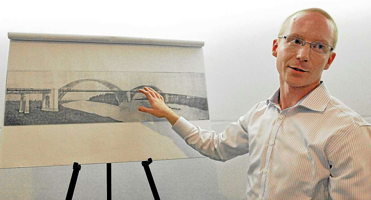 Cromwell resident Jonathan Ives, a structural engineer at URS Corporation in Rocky Hill shows one of the four proposed designs of the Middletown-Portland Bridge during a presentation celebrating 75th anniversary of the Arrigoni Bridge. The program was held at the Portland Public Library and was hosted by the Portland Historical Society. Catherine Avalone - The Middletown Press
