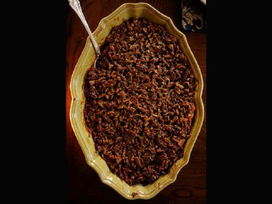 "The praline pecan topped yams from the ""Tomsgiving"" classics of Tom Ryan who started Smashburger and Tom's Urban 24 at his Denver home on Saturday, November 9, 2013. / Copyright - 2013 The Denver Post, MediaNews Group."