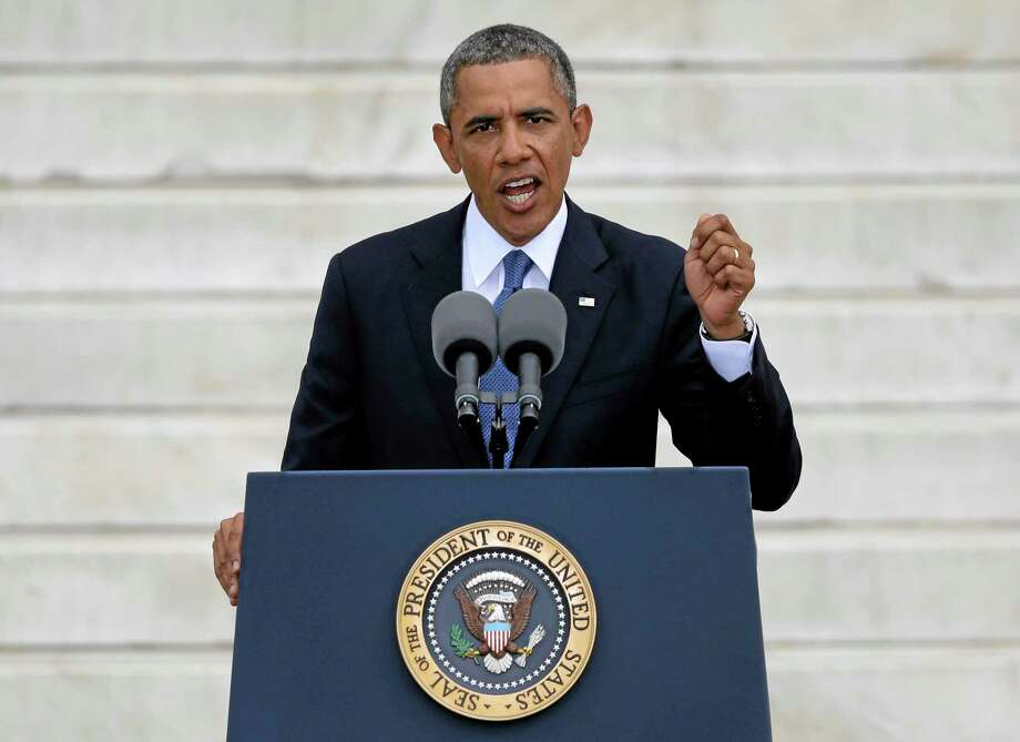 President barack Obama speaks on the steps of the Lincoln Memorial in Washington, Wednesday, Aug. 28, 2013, during a ceremony to commemorate the 50th Anniversary of the 1963 March on Washington for Jobs and Freedom. (AP Photo/Carolyn Kaster) Photo: AP / AP