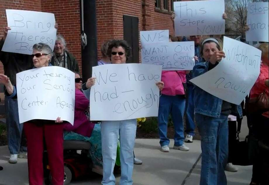 Cromwell residents protested outside town hall last week in support of Theresa Strong