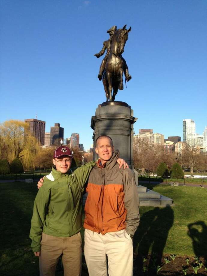 Sanford (right) with son Matthew in Boston. Contributed photo.