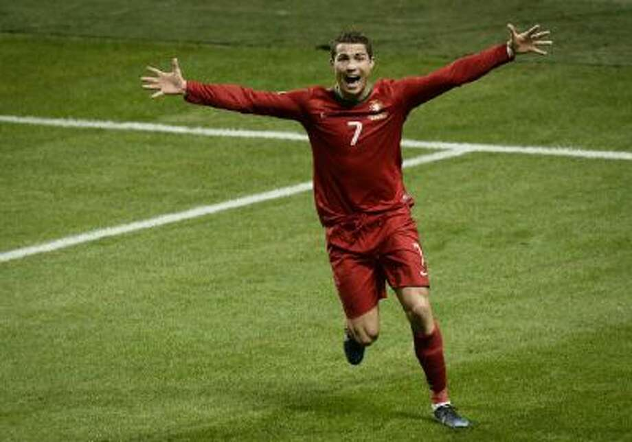 Portugal's Cristiano Ronaldo celebrates after scoring the 2-3 goal during the World Cup 2014 qualifying playoff second leg soccer match between Sweden and Portugal at Friends Arena in Stockholm, Tuesday, Nov. 19, 2013.