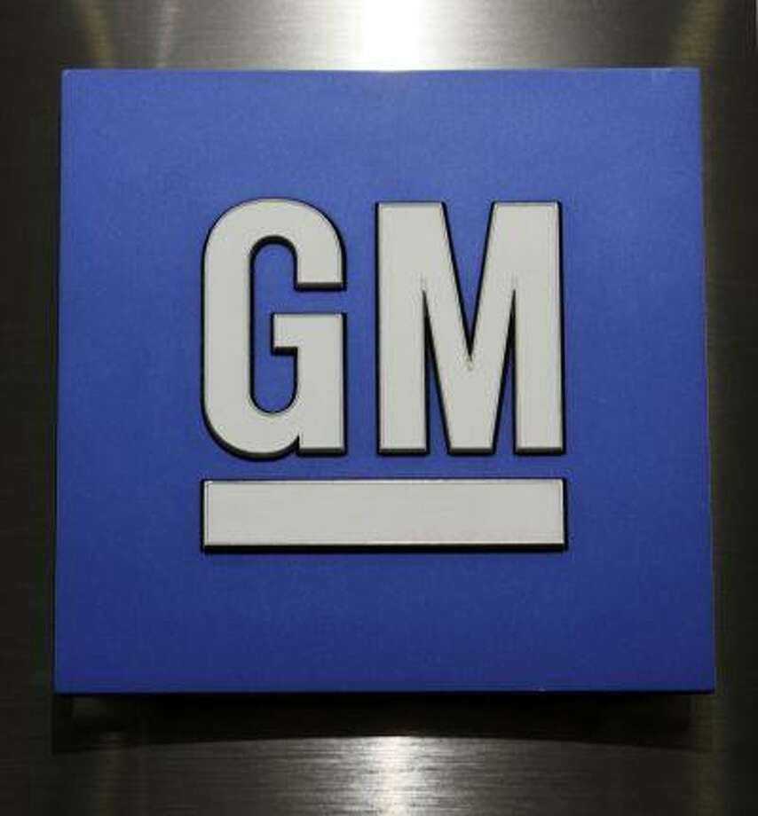 A General Motors logo is shown during a news conference in Detroit in 2010. Photo: ASSOCIATED PRESS / A2010
