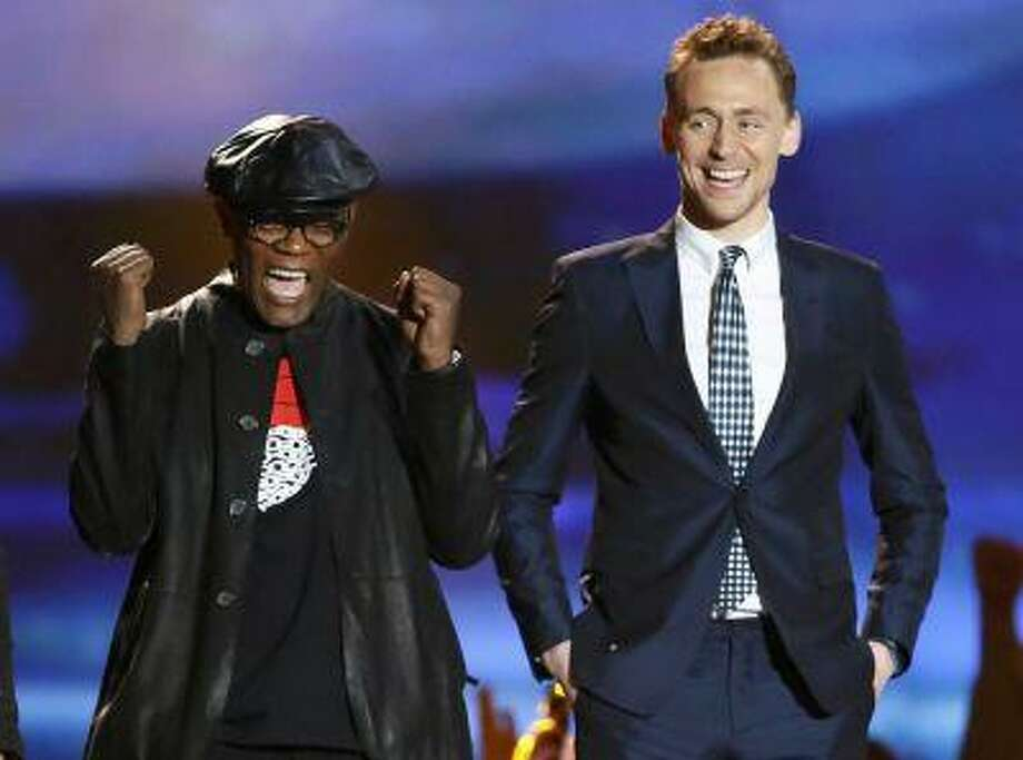 "Actors Samuel L. Jackson (L) and Tom Hiddleston react as they accept the award for movie of the year for ""The Avengers"" at the 2013 MTV Movie Awards in Culver City, California April 14, 2013. REUTERS/Danny Moloshok (UNITED STATES Tags: Entertainment TPX IMAGES OF THE DAY) (MTV-SHOW) Photo: REUTERS / X01907"