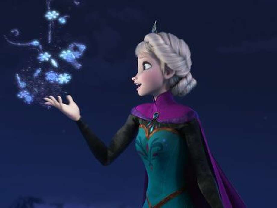 In a photo distributed by Disney, Princess Elsa performs magic during the new animated film, 'Frozen,' which opens in theaters on Friday, Nov. 22, 2013.
