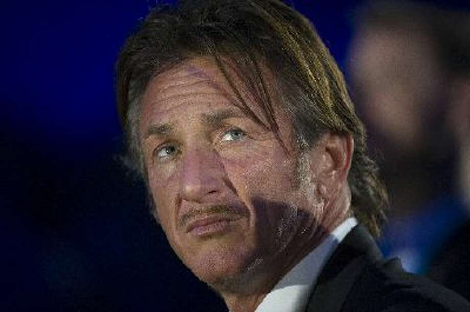 Actor and director Sean Penn listens during the DreamForce Conference in San Francisco, California, on Tuesday, Nov. 19, 2013.