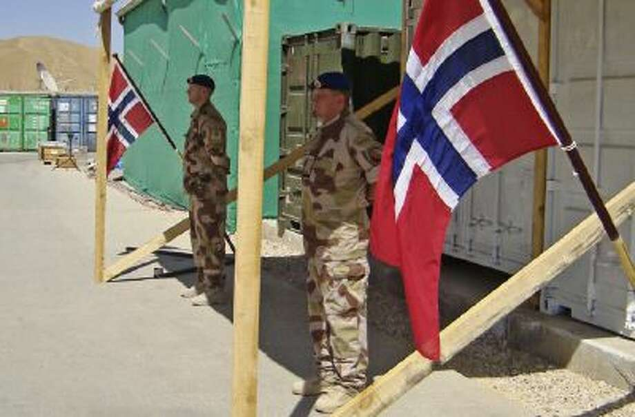 Norwegian soldiers stand in attention at their base in Faryab province, north of Kabul, Afghanistan, on June 29, 2010.