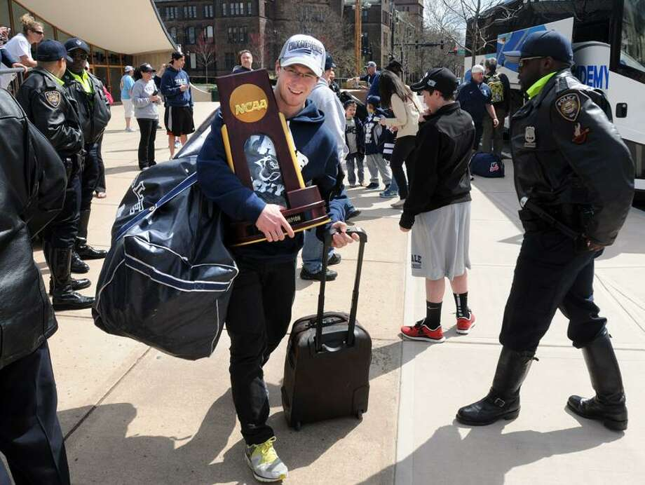 The NCAA men's national hockey champions, Yale University, returns home from the Frozen Four in Pittsburgh, where they beat crosstown rivals Quinnipiac Univeristy, 4-0. You'd think that would get you a little cred but team captain Andrew Miller carried his own bags along with the trophy. Mara Lavitt/New Haven Register