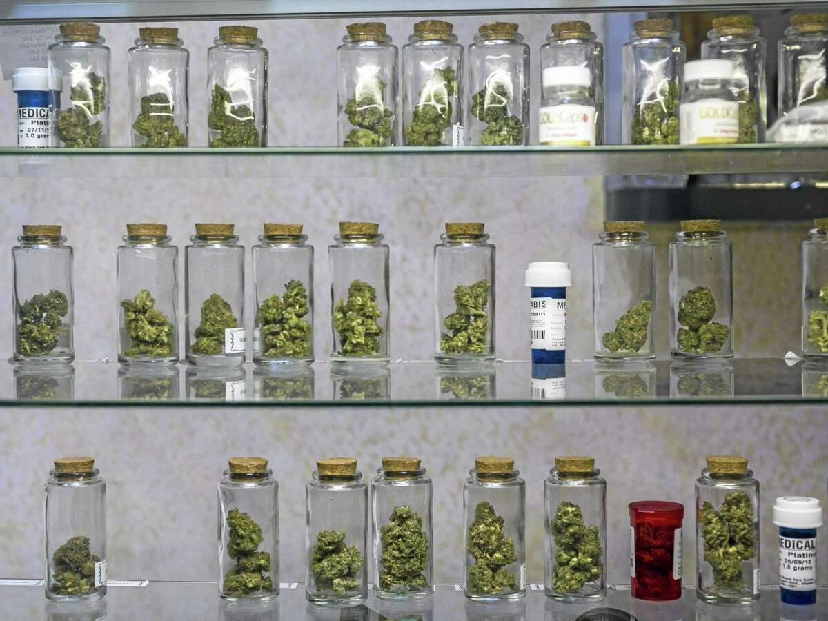 FILE - This May 14, 2013 file photo shows medical marijuana vials displayed at the Venice Beach Care Center medical marijuana dispensary in Venice, Calif. (AP Photo/Damian Dovarganes)