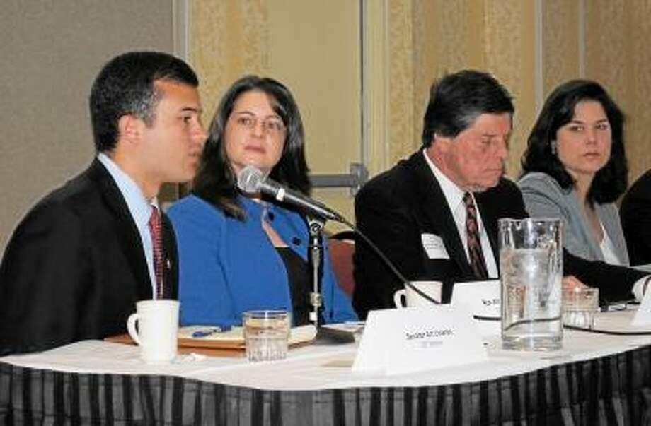 Art Linares, left, speaks at a recent legislative breakfast in Cromwell.