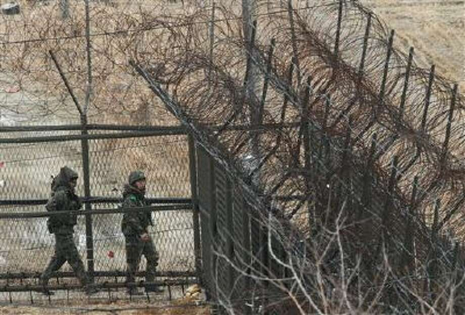 South Korean soldiers patrol the barbed-wire fence at the border village of Panmunjom, the demilitarized zone which has separated the two Koreas since the Korean War, on March 27, 2012. Photo: AP / AP