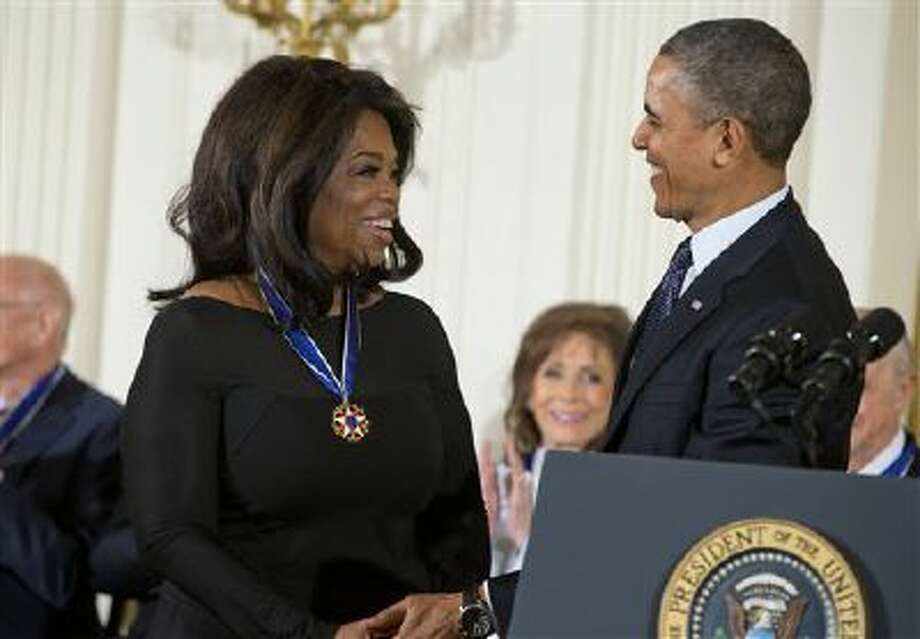 President Barack Obama smiles after awarding Oprah Winfrey the Presidential Medal of Freedom in the East Room of the White House on Wednesday, Nov. 20, 2013 in Washington. (AP Photo/ Evan Vucci) Photo: AP / AP
