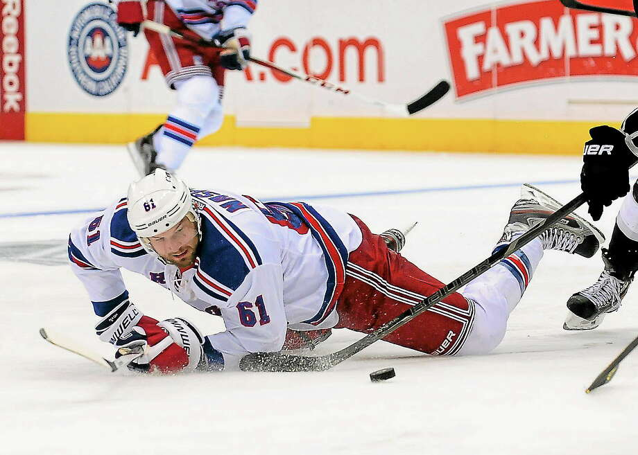 Rangers left wing Rick Nash battles for the puck during New York's Oct. 7 game against the Kings in Los Angeles. Photo: Gus Ruelas — The Associated Press  / AP2013