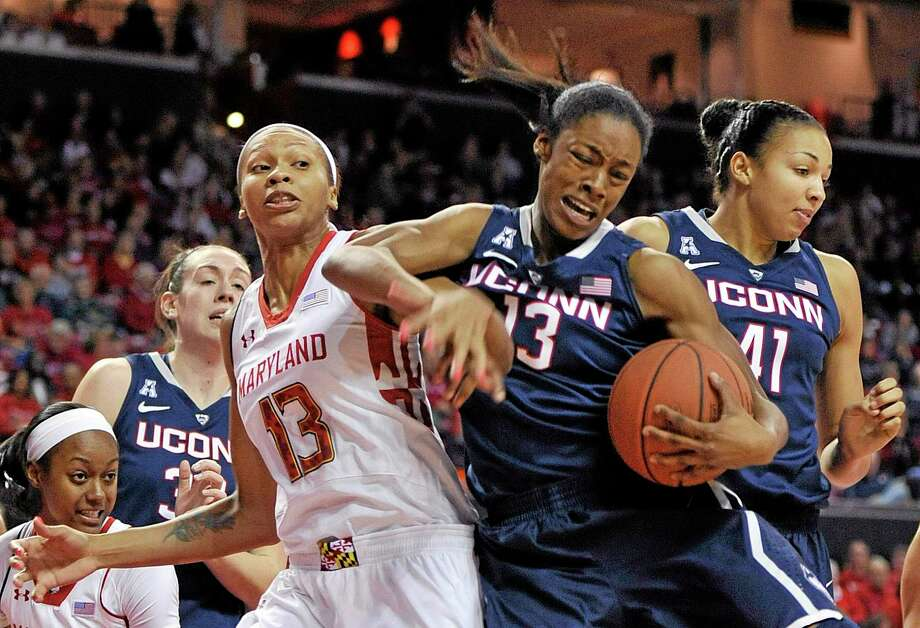 UConn's Brianna Banks, right, and Maryland's Alicia DeVaughn, left, reach for the ball. Photo: Gail Burton — The Associated Press  / FR4095 AP
