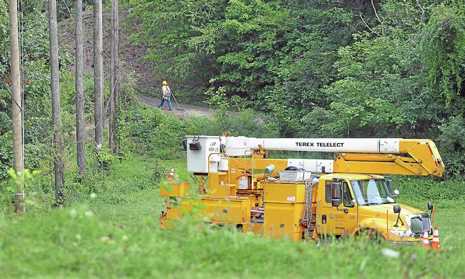 Connecticut Light & Power employees finish work early Monday afternoon at Powder Ridge Mountain Park & Resort. Power is expected to be returned this week. Photo: Journal Register Co. / TheMiddletownPress