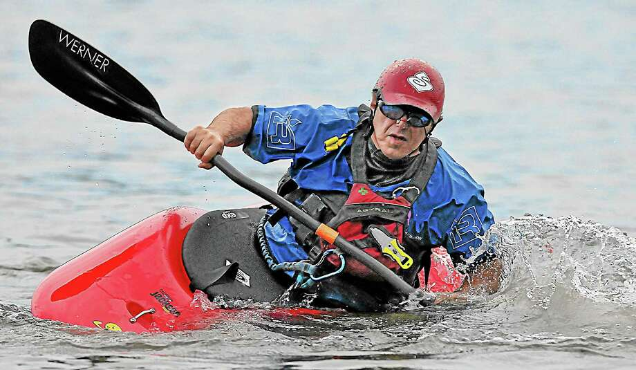 Deep River resident Dennis Wigg, a volunteer kayak instructor demonstrates a roll technique at Lake Beseck in Middlefield Monday evening. The Appalachian Mountain Club Whitewater will continue classes at Woodrow Wilson Middle School pool. Visit their website at www.ct-amc.org. Catherine Avalone - The Middletown Press Photo: Journal Register Co. / TheMiddletownPress