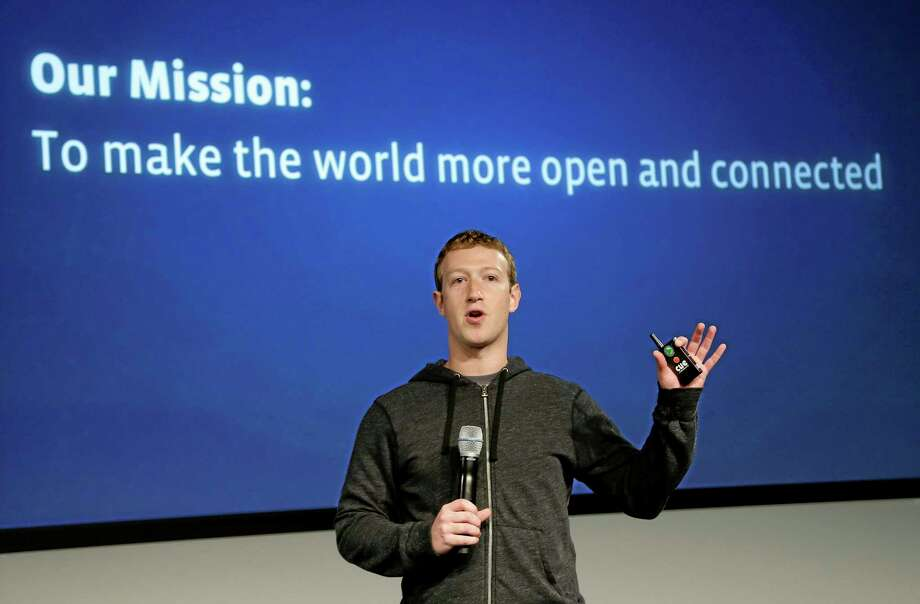 FILE - In this Thursday, March 7, 2013 file photo, Facebook CEO Mark Zuckerberg speaks at the company's headquarters in Menlo Park, Calif. Facebook wants to get more of the world's more than 7 billion people online through a partnership with some of the world's largest mobile technology companies. Facebook Inc. announced a partnership called Internet.org on Wednesday, Aug. 21, 2013. (AP Photo/Jeff Chiu) Photo: AP / AP