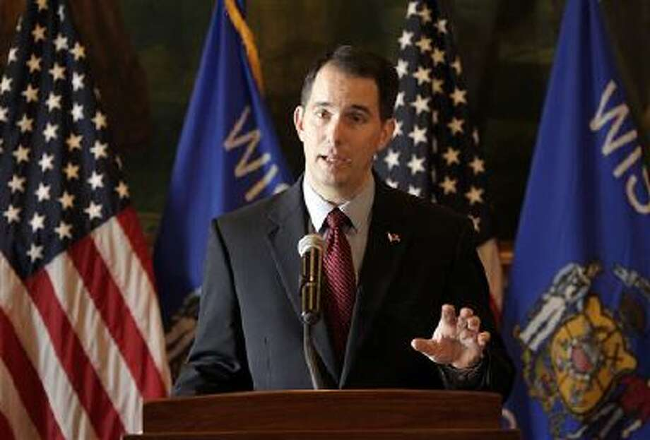 Wisconsin Gov. Scott Walker talks about his call for a special session of the Legislature to delay shifting more than 100,000 Wisconsinites to the federal health insurance exchange. Walker says he wants to see the deadline moved to April 1. That would give people more time to get insurance through the online exchange created under the federal health overhaul. Photo: AP / Wisconsin State Journal