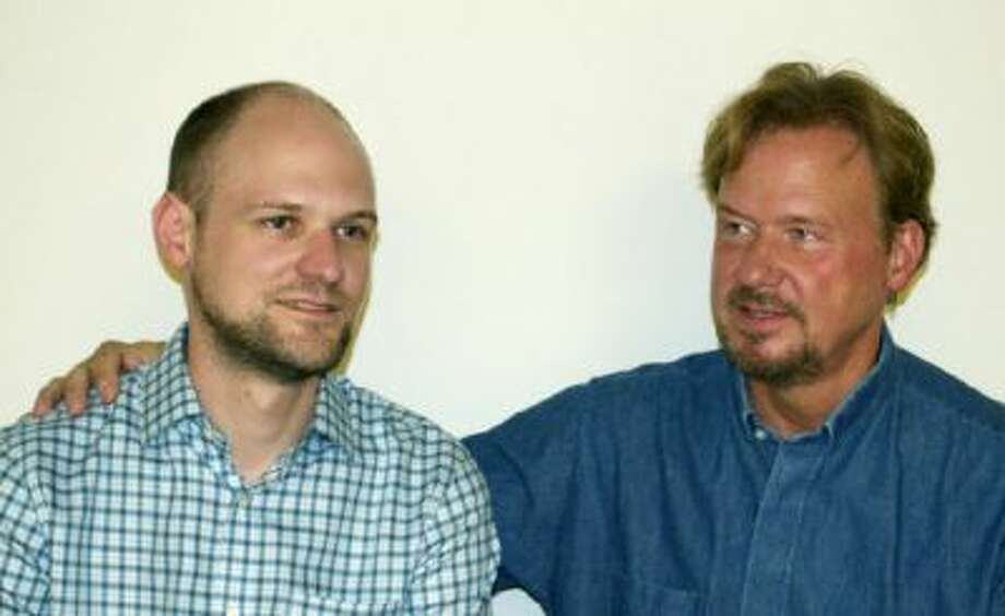 In a family photo dated September, the Rev. Frank Schaefer, right, sits with his son, Tim. The elder Schaefer, 51, was convicted under United Methodist law on Monday of officiating Tim's same-sex wedding in Massachusetts in 2007.
