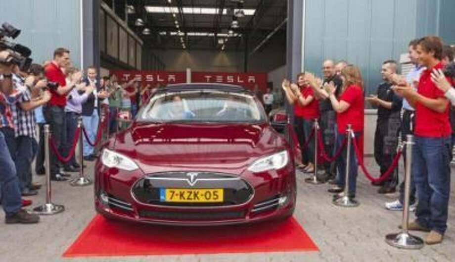 The first Model S leaves the new European Tesla assembly plant in Tilburg, The Netherlands. (PR Newswire/Tesla Motors)