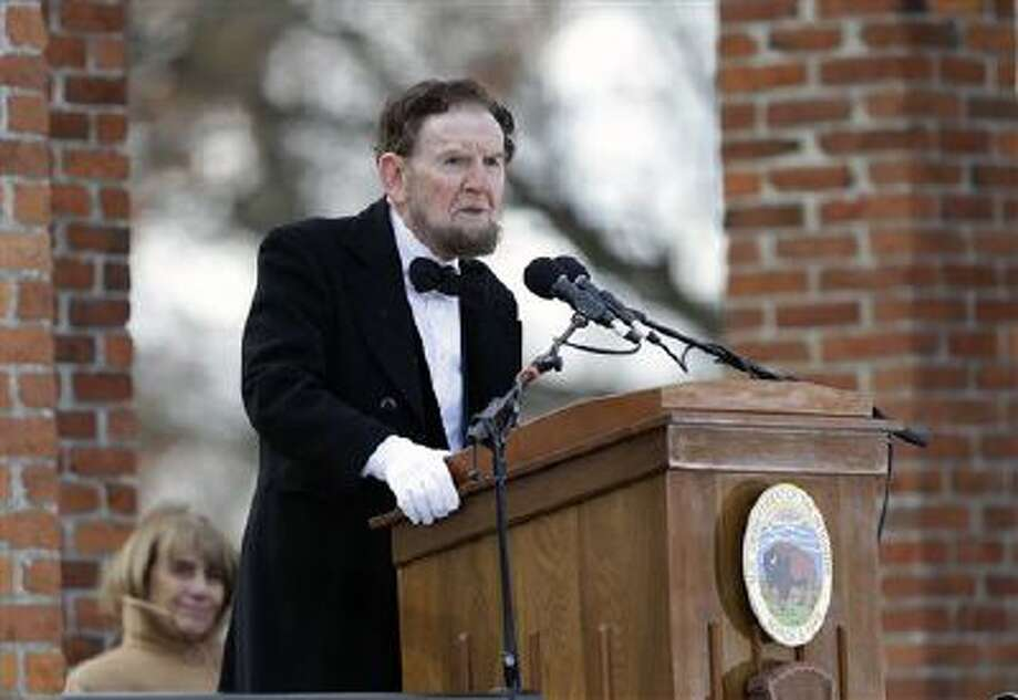 James Getty, portraying President Abraham Lincoln, recites the Gettysburg Address during a ceremony Tuesday commemorating the 150th anniversary of the dedication of the Soldiers' National Cemetery and the historic speech in Gettysburg, Pa. Lincoln's speech was first delivered in Gettysburg nearly five months after the major battle in 1863 that left tens of thousands of men wounded, dead or missing. Photo: AP / AP