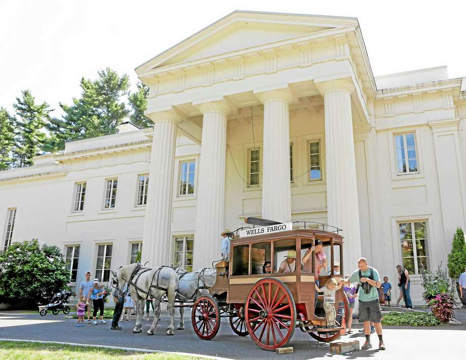 Lines form to ride the horse drawn carriage during Sunday's Open Air Market held at Wadsworth Mansion.  Many took advantage of the beautiful summer day and the Market which hosted many vendors from Connecticut. Photo: Journal Register Co.