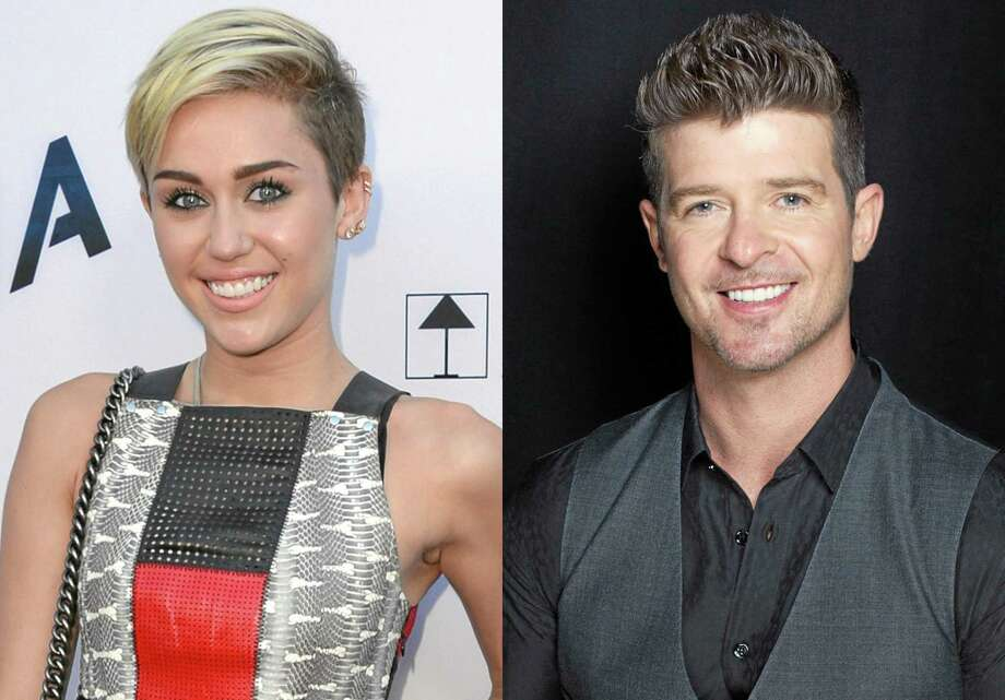 This combination of August 2013 file photos shows Miley Cyrus, left, in Los Angeles and Robin Thicke in New York. Cyrus and Thicke are scheduled to perform their summer anthems at the MTV Video Music Awards on Aug. 25, 2013. (Photo by Jordan Strauss, Victoria Will/Invision/AP) Photo: AP / Invision