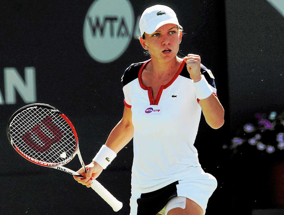 (Bob Child-for the New Haven Register)    Simona Halep clenches her fist after scoring a point against Petra Kvitova         in their championship singles match at the New Haven Open. Saturday, Aug.24, 2013. Photo: New Haven Register