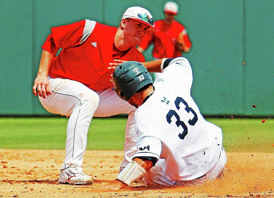Seymour's John Murphy, shown here tagging out a runner while at Sacred Heart, is currently a shortstop with the Staten Island Yankees. Photo: Karl B. DeBlaker — The Associated Press  / FR7226 AP