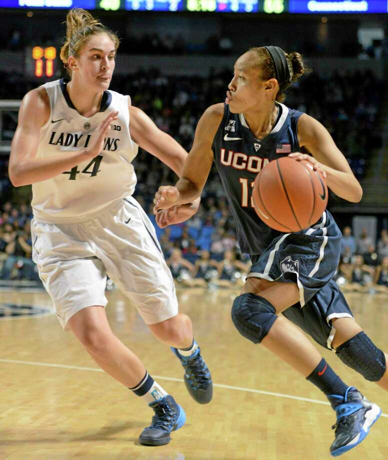 UConn's Saniya Chong, right, drives  past Penn State's Tori Waldner in the second half on Sunday. Photo: John Beale — The Associated Press  / FR157268 AP