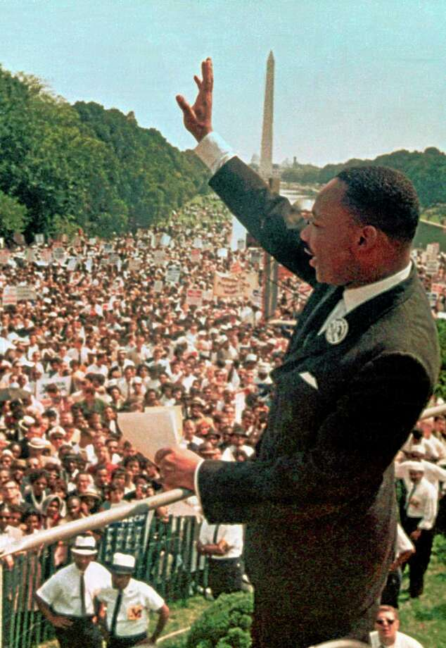 "FILE - This Aug. 28, 1963, file photo shows Dr. Martin Luther King Jr. acknowledging the crowd at the Lincoln Memorial for his ""I Have a Dream"" speech during the March on Washington. Next Wednesday, the nation's first black president will stand near the spot where Martin Luther King Jr. stood 50 years ago, a living symbol of the racial progress King dreamed about, and enunciate where he believes this nation should be headed. (AP Photo/File) Photo: AP / AP"