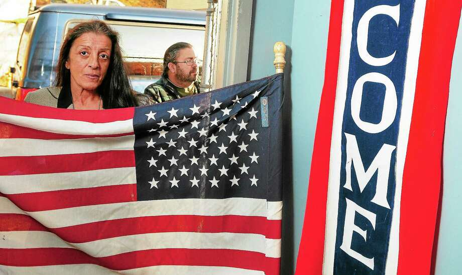Mary Porter, left, CEO and executive director of No Vet Left Behind, and Army veteran Joseph Oliveras of Seymour are seen at the Stars and Stripes Thrift Shoppe in Ansonia. Photo: Peter Hvizdak — New Haven Register         / ©Peter Hvizdak /  New Haven Register