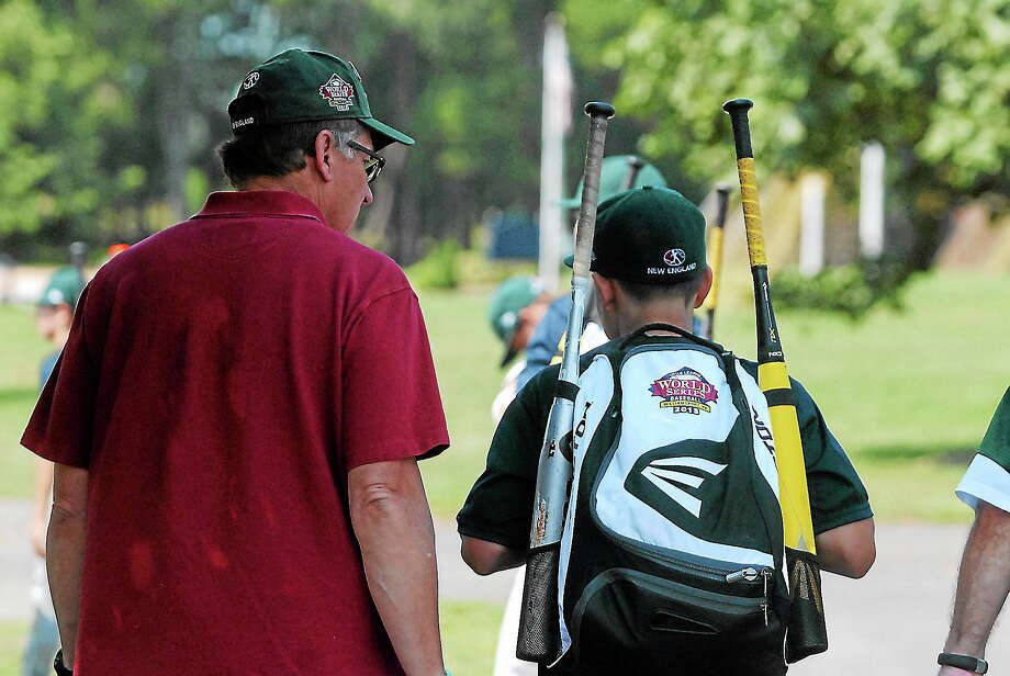 Chad Knight and his father Craig walk together after a practice this past week at the Little League World Series in South Williamsport, Pa. Knight will be the starting pitcher for Westport on Saturday against Chula Vista, Calif. at 3:30 pm. on ABC. Photo: Journal Register Co.