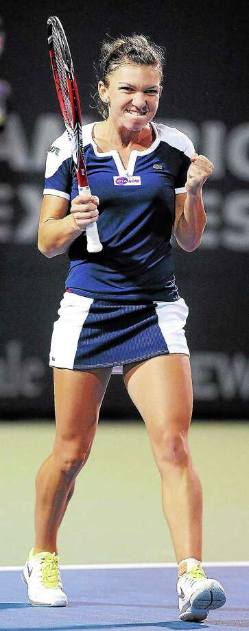 Arnold Gold — RegisterSimona Halep celebrates her 6-2, 7-5 victory over Caroline Wozniacki in a semi-final match at the New Haven Open at Yale on 8/23/2013. Photo: Journal Register Co.