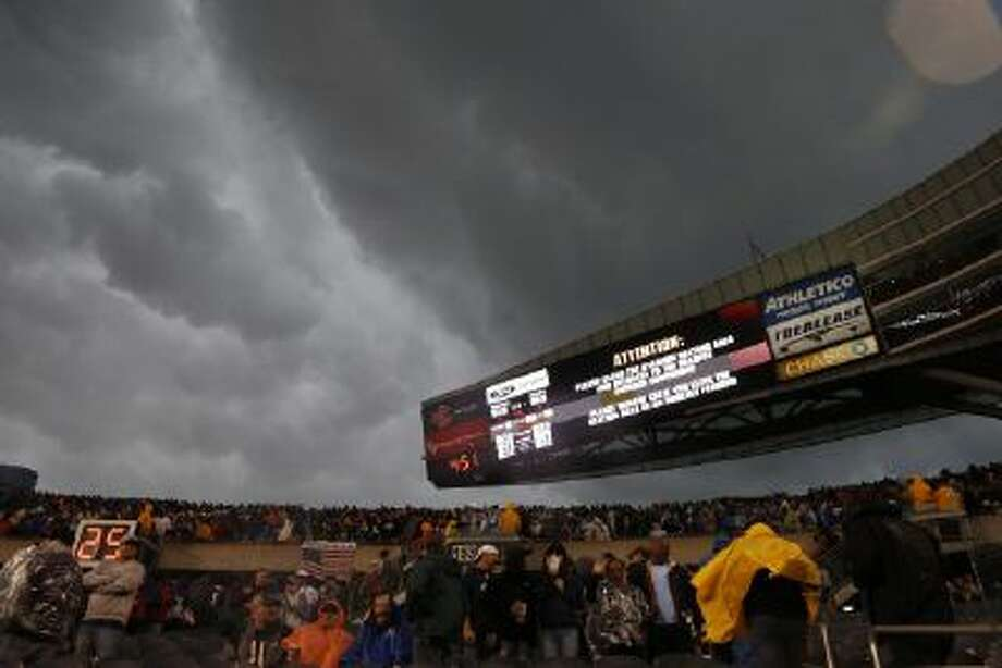 Fans are advised to leave the stadium as severe weather passes over Soldier Field