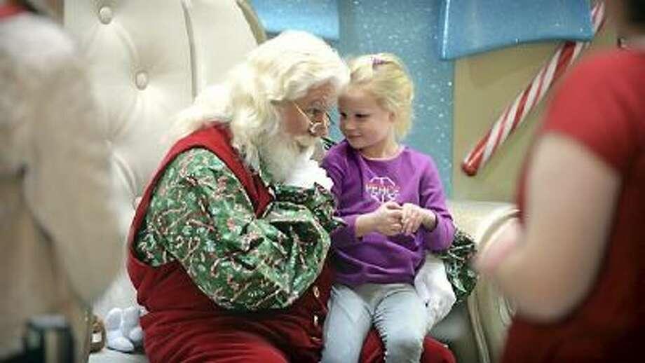 A young customer visits Santa at Mall of America, Thursday, November 14, 2013.