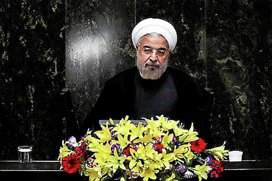 FILE - In this Aug. 15, 2013, file photo, Iranian President Hasan Rouhani speaks during the debate on the proposed Cabinet at the parliament, in Tehran, Iran. New signs are emerging that international sanctions are taking a deepening toll on Iran's economy _ putting tens of billions of dollars in oil money out of the government's reach.  Yet there is no indication the distress is achieving the West's ultimate goal of forcing the Islamic Republic to halt its nuclear program. (AP Photo/Ebrahim Noroozi) Photo: AP / AP