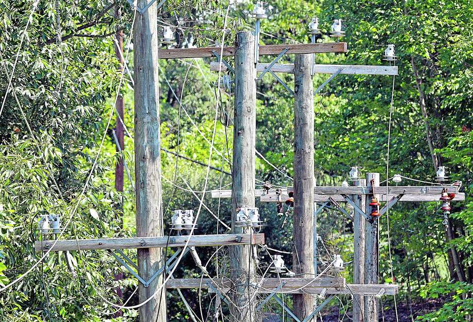 The five utility poles at the entrance gate at Powder Ridge in Middlefield have been replaced by AT&T and power is expected to be connected as early as Monday. Catherine Avalone — The Middletown Press Photo: Journal Register Co. / TheMiddletownPress