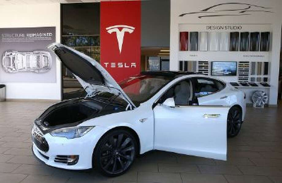 A Tesla Model S car is displayed at a Tesla showroom in Palo Alto, Calif. Photo: Getty Images / 2013 Getty Images