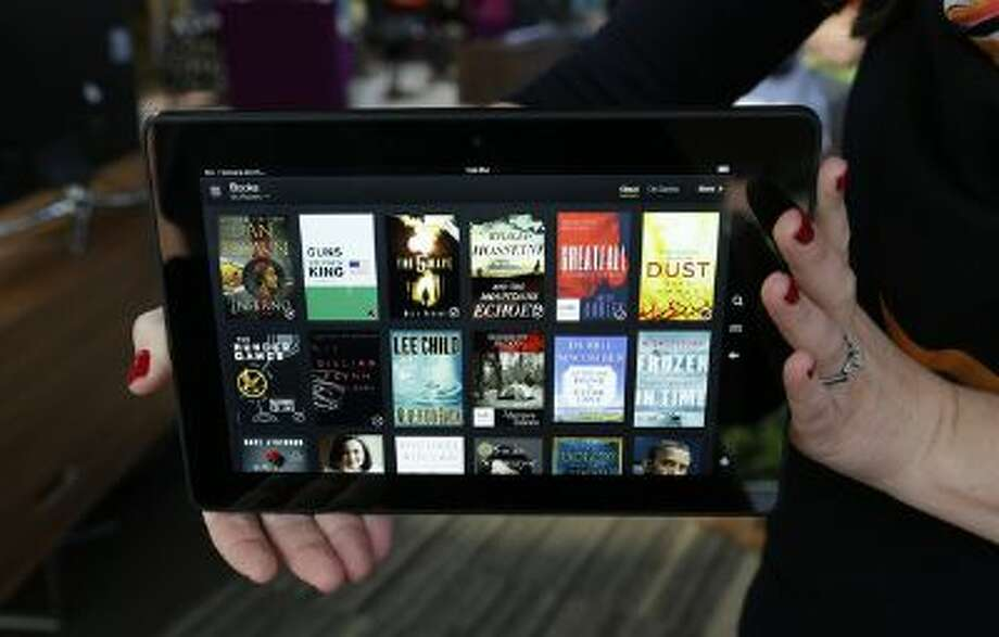 The 8.9-inch Amazon Kindle HDX tablet computer is shown Tuesday, Sept. 24, 2013, in Seattle. Photo: AP / AP net
