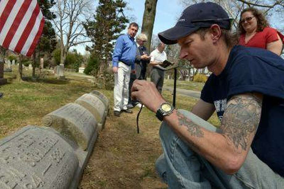 Relic hunger John Blue takes a snapshot at the headstone for Pvt. Levi Schlegel in Reading, Pa. Photo: ThE WASHINGTON POST / THE WASHINGTON POST
