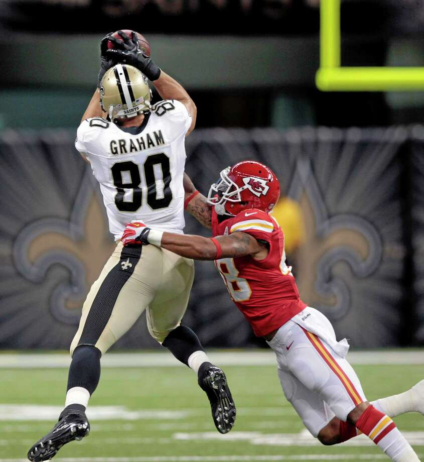 New Orleans Saints tight end Jimmy Graham (80) pulls in a pass over Kansas City Chiefs safety Bradley McDougald during the first half of an NFL preseason football game at the Mercedes-Benz Superdome in New Orleans, Friday, Aug. 9, 2013. (AP Photo/Matthew Hinton) Photo: AP / FR170690 AP