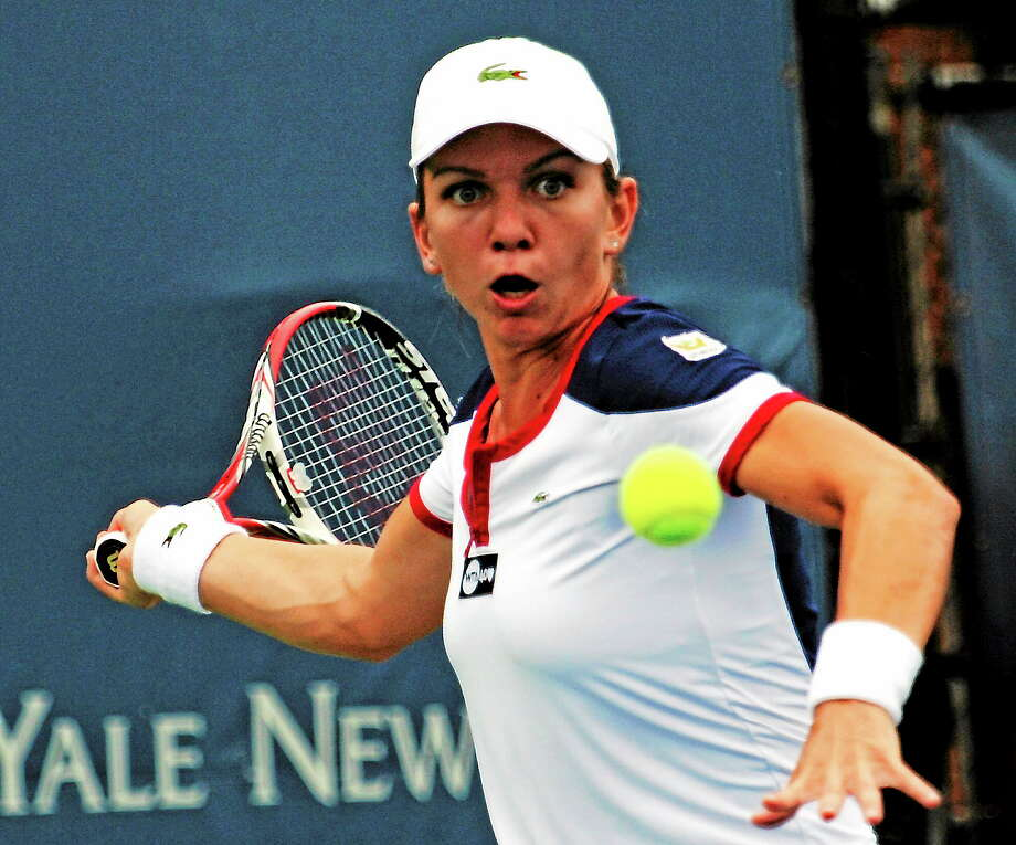 Simona Halep recorded a 6-1, 7-6 (6) win over Ekaterina Makarova in a quarterfinal match Thursday at the New Haven Open in New Haven. Photo: BOB CHILD — FOR THE REGISTER